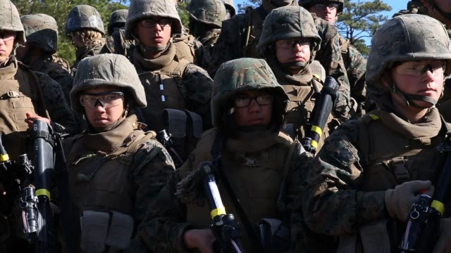 male and female marines listen to instructions during a combat marksmanship course at marine combat training on february 20 2013 at camp lejeune... - infantry stock videos and b-roll footage