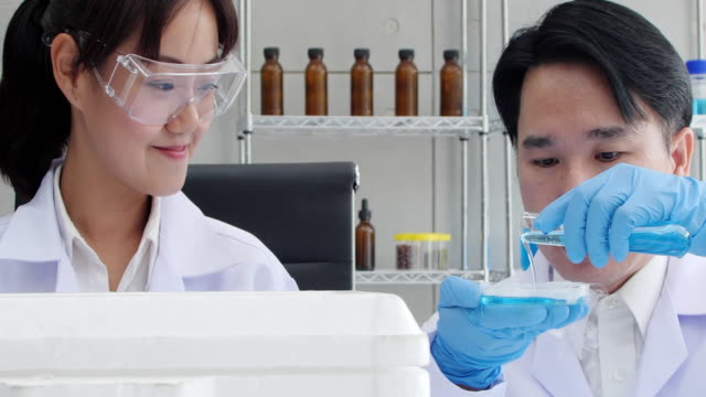 male and female scientist are working in a laboratory.health care researchers working in life science laboratory. - heterosexual couple stock videos & royalty-free footage