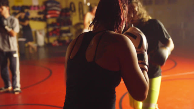 male and female spar in gym - muay thai stock videos and b-roll footage