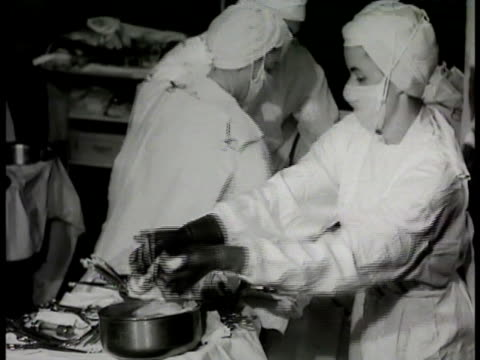 male anesthetist w/ mask on female patient, respiration bag, wall clock 8:48, nurse passing swab, surgical instruments to doctor, team working w/... - 1948 stock videos & royalty-free footage