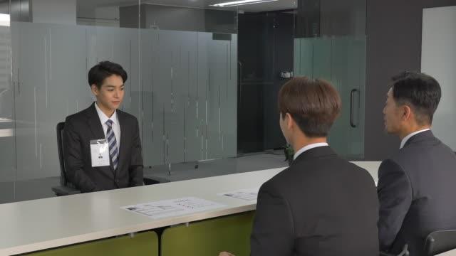 male applicant having an interview - hemd und krawatte stock-videos und b-roll-filmmaterial
