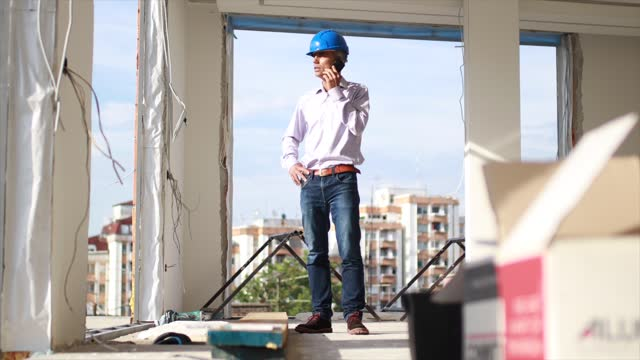 male architect inspecting the construction site - headwear stock videos & royalty-free footage