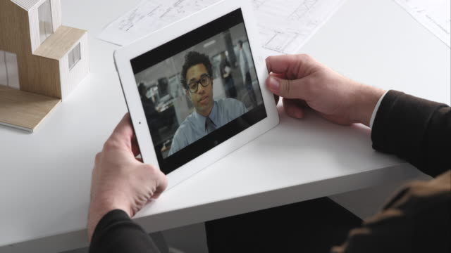 Male architect on video call with his associate