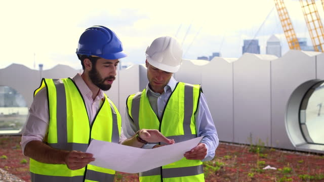 Male architect with blueprint