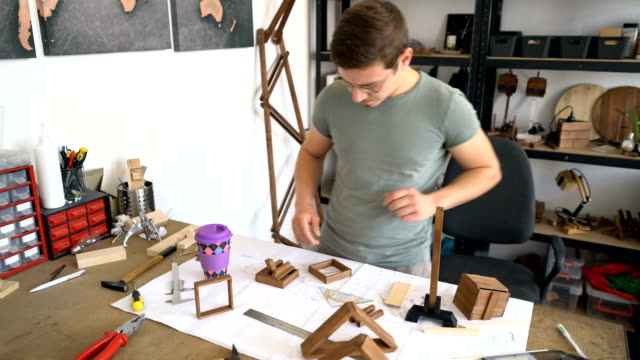 male artisan assembling wooden parts. - calliper stock videos and b-roll footage