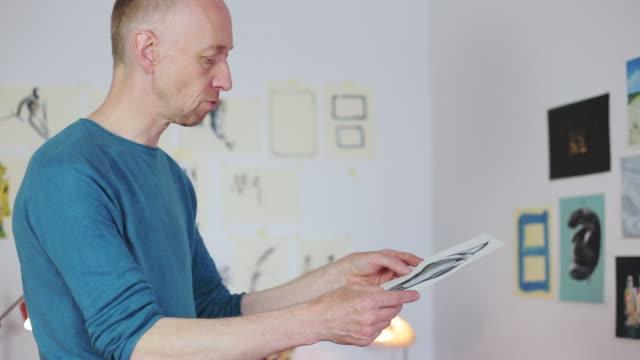 Male artist analyzing a draw.