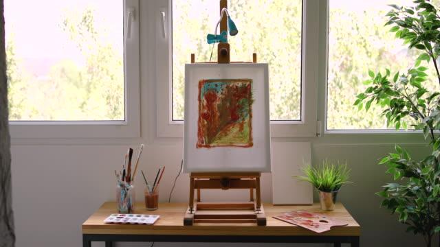 male artist decorating his art studio - painter artist stock videos & royalty-free footage