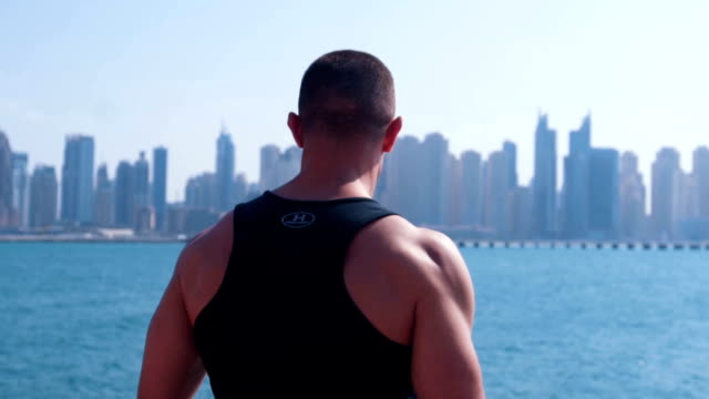 male athlete admire view od dubai marina - sports clothing stock videos & royalty-free footage