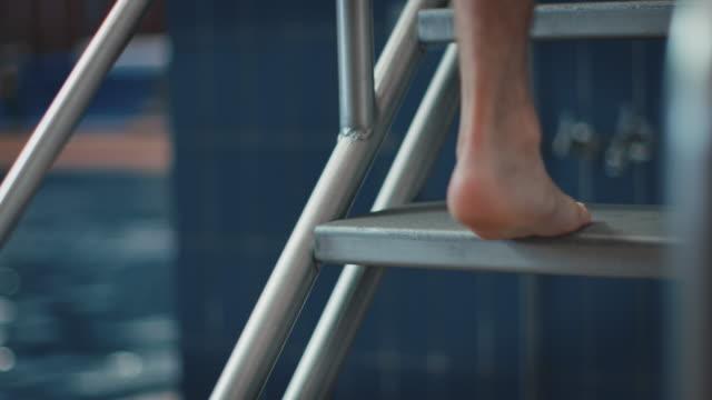 male athlete climbing on diving platform - diving platform stock videos & royalty-free footage
