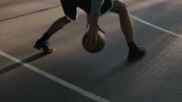 Male athlete dribbling ball on basketball court