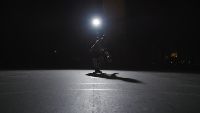 male athlete dribbling basketball at night - skill stock videos & royalty-free footage