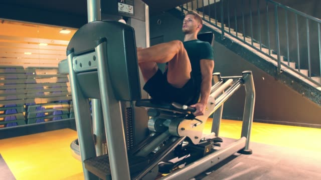 male athlete focusing on breathing while using leg press - exercise machine stock videos & royalty-free footage