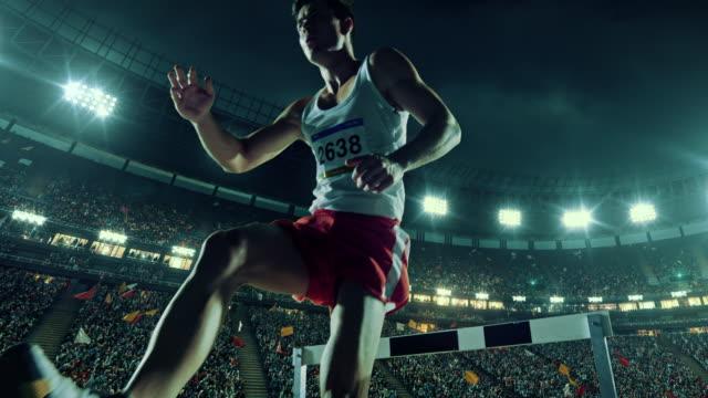 Male athlete hurdle on sports race