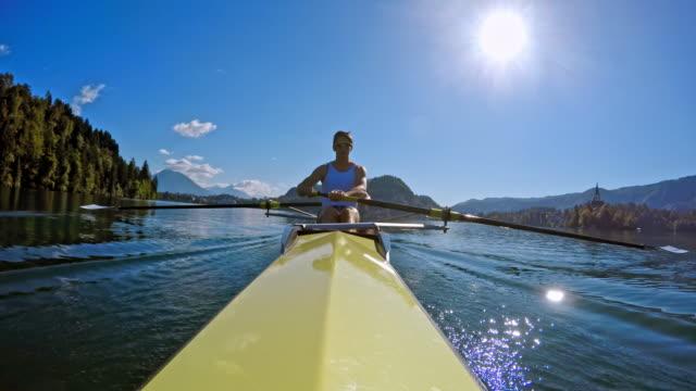 pov male athlete in a coxless pair rowing in sunshine - canottaggio senza timoniere video stock e b–roll