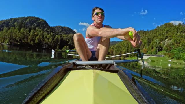 pov male athlete in a yellow coxless pair rowing in sunshine - canottaggio senza timoniere video stock e b–roll