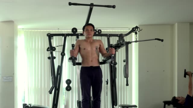 male athlete is pull up on exercise machine - exercise machine stock videos & royalty-free footage