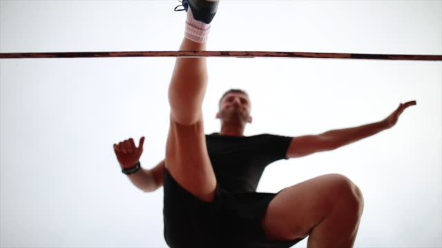 male athlete jumping over hurdle - hurdle stock videos & royalty-free footage