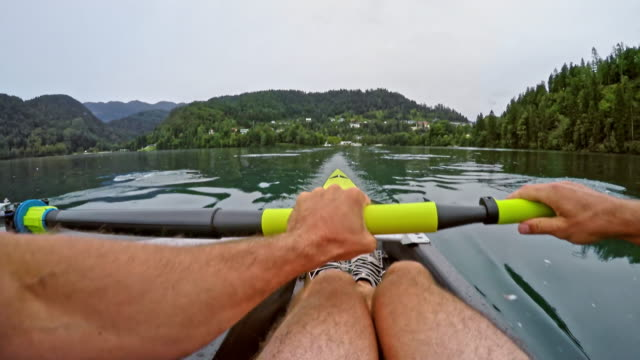 pov male athlete rowing - scull stock videos & royalty-free footage