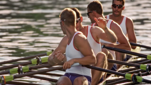 slo mo male athletes in quad scull shaking hands - rowing stock videos & royalty-free footage