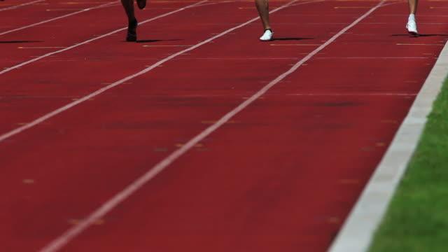 male athletes sprinting medium shot - running race stock videos and b-roll footage