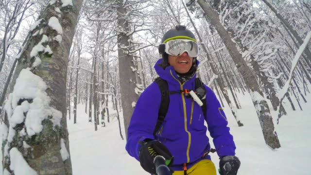 POV Male backcountry skier enjoying the ride in powder snow