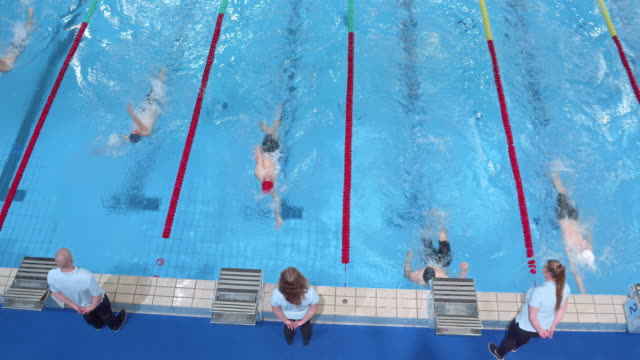 AERIAL Male backstroke style swimming competition finish