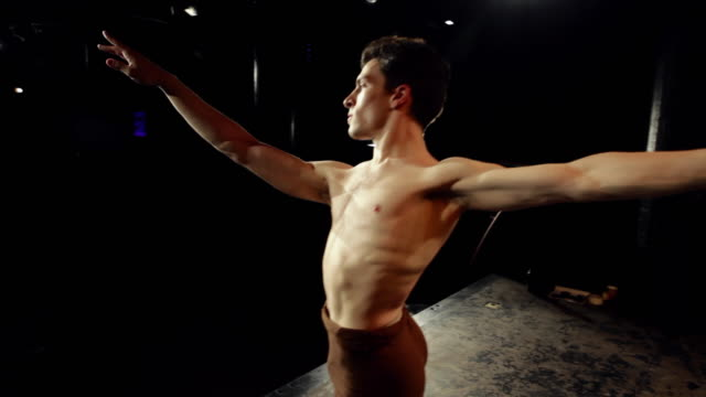 ms male ballet dancer on stage practicing his dance routine, pirouetting under the stage lights / new york city, new york, usa - ballet shoe stock videos and b-roll footage