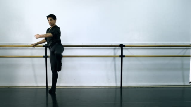 ws male ballet dancer warming up on bar / los angles, california, usa  - barre fitness stock videos and b-roll footage
