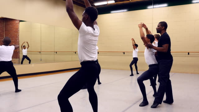 ms male ballet instructor adjusting students form during dance class - tights stock videos and b-roll footage