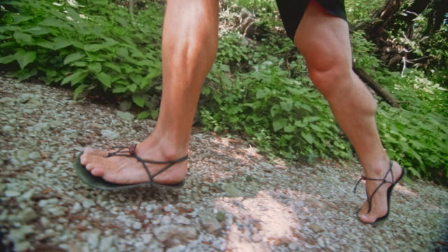 slo mo ts male barefooter running up the forest trail - human leg stock videos & royalty-free footage