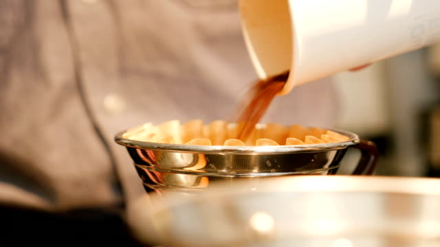 male barista pouring ground coffee into dripper - one man only stock videos & royalty-free footage