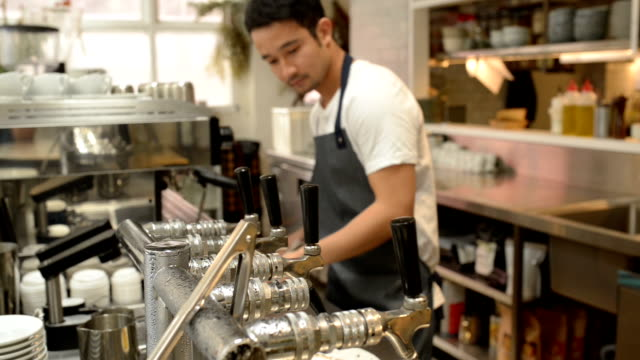 male barista preparing coffee in cafe. - barista stock videos and b-roll footage