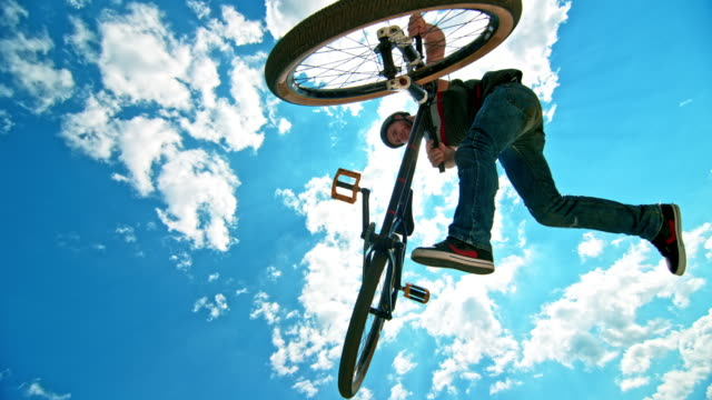 speed ramp male biker turning his dirt jump bike while airborne - one mid adult man only stock videos & royalty-free footage