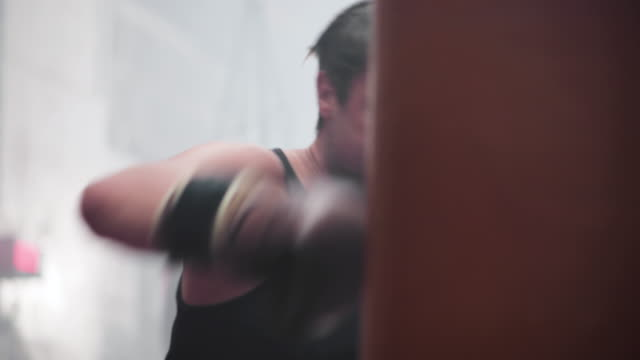 male boxer punching a punch bag - military training stock videos & royalty-free footage
