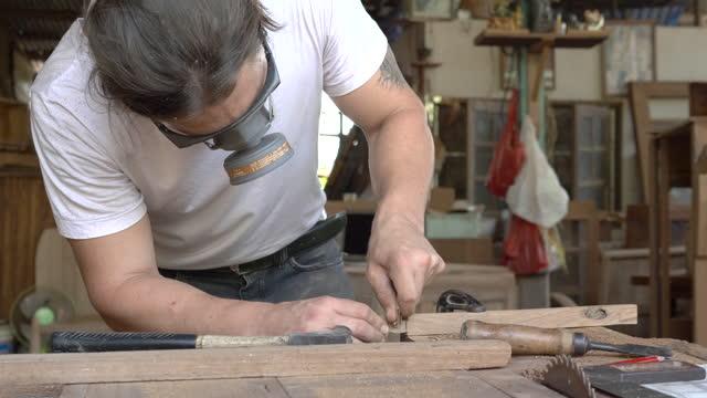 male carpenter in furniture workshop assembling - work tool stock videos & royalty-free footage