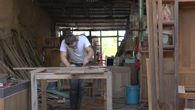 male carpenter in furniture workshop assembling - hipster culture stock videos & royalty-free footage