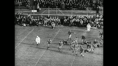 male cheerleaders on field doing backflips. game play: hike to running w/ football making touch down. band cheering in stands holding up hats. male... - 1936 stock videos & royalty-free footage