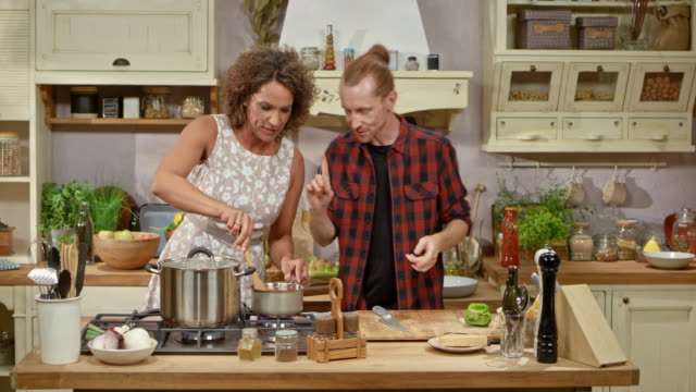 male chef and his female guest on the show cooking a tomato sauce - stirring stock videos & royalty-free footage