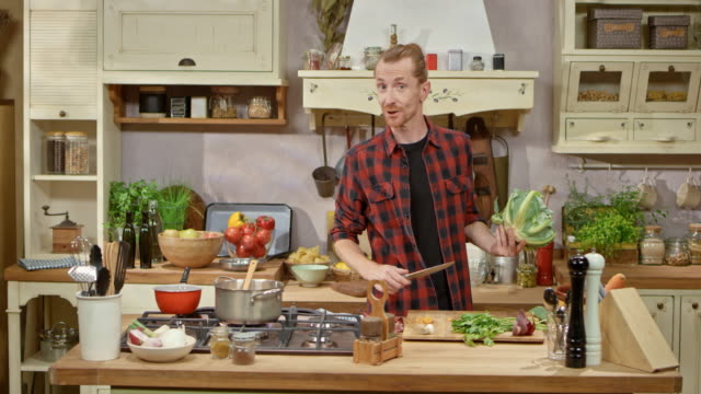 male chef preparing a vegetable soup on a cooking show - showing stock videos and b-roll footage