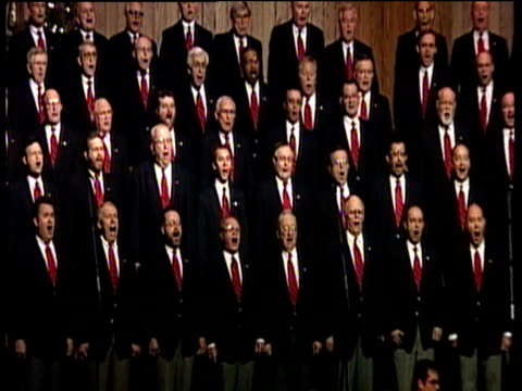 Male choir singing with orchestra and massive congregation in Louisville Megachurch