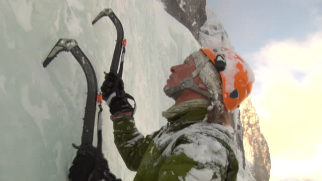 cu tu male climber climbing ice using hooks, hemsedal, buskerud, norway - climbing equipment stock videos and b-roll footage