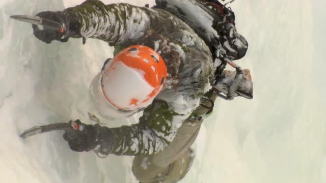 CU ZO WS HA Male climber climbing ice using hooks, Hemsedal, Buskerud, Norway