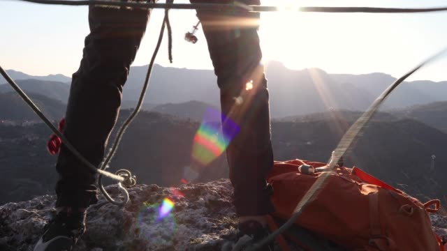 male climber organizes rope on mountain summit - climbing rope stock videos & royalty-free footage