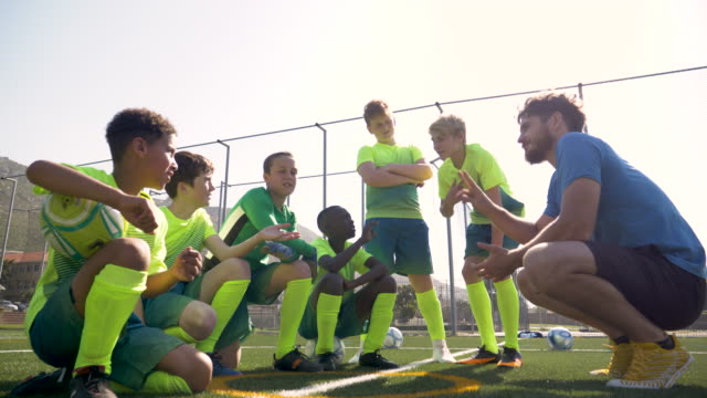 male coach preparing his team for a soccer match - coach stock videos & royalty-free footage