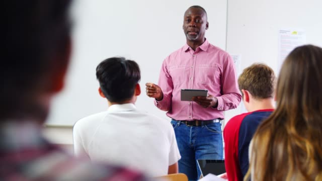 Male College Tutor With Digital Tablet Teaching Class