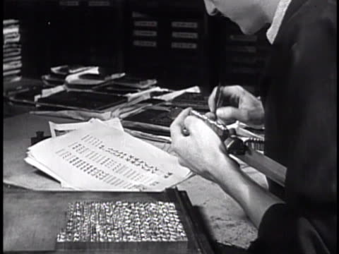 presses male compositor arranging printing press typeface cu fingers placing letter blocks into tray typesetting two male translators working at desk... - state of the vatican city stock videos & royalty-free footage