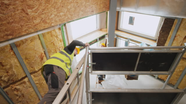 male construction worker climbing up a scaffold - ladder stock videos and b-roll footage