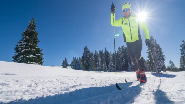 male cross country skier in a winter landscape - striding stock videos & royalty-free footage