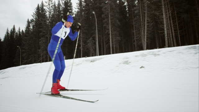 slo mo male cross country skiing athlete approaching his goal - competition stock videos & royalty-free footage