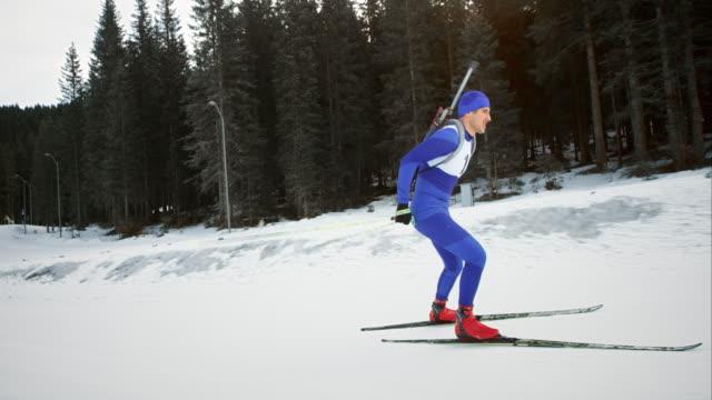 slo mo male cross country skiing athlete skating - pokljuka stock videos and b-roll footage